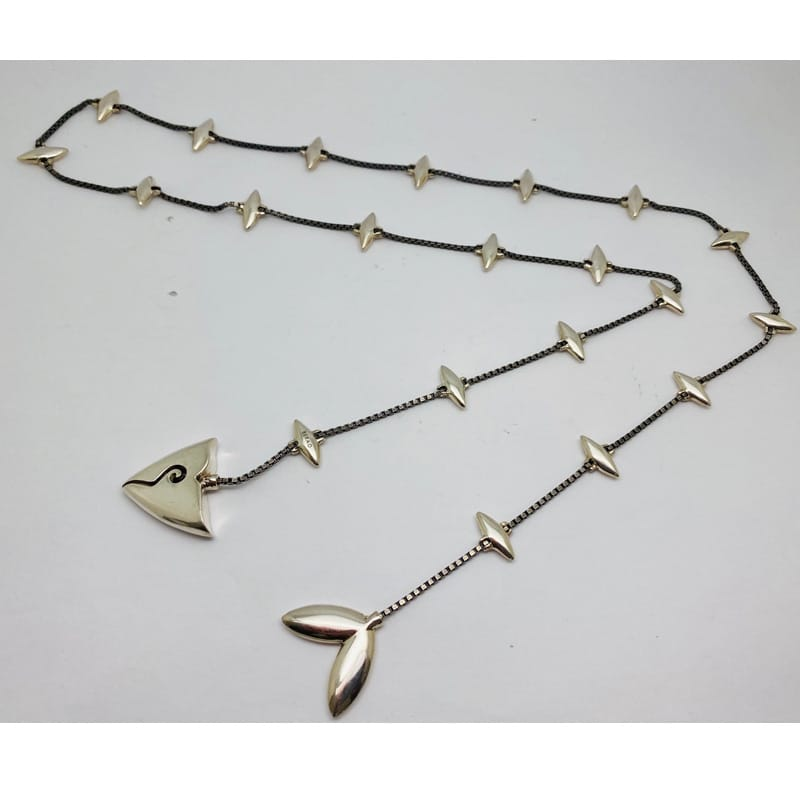 Silver necklace as a fish-scraped scarf