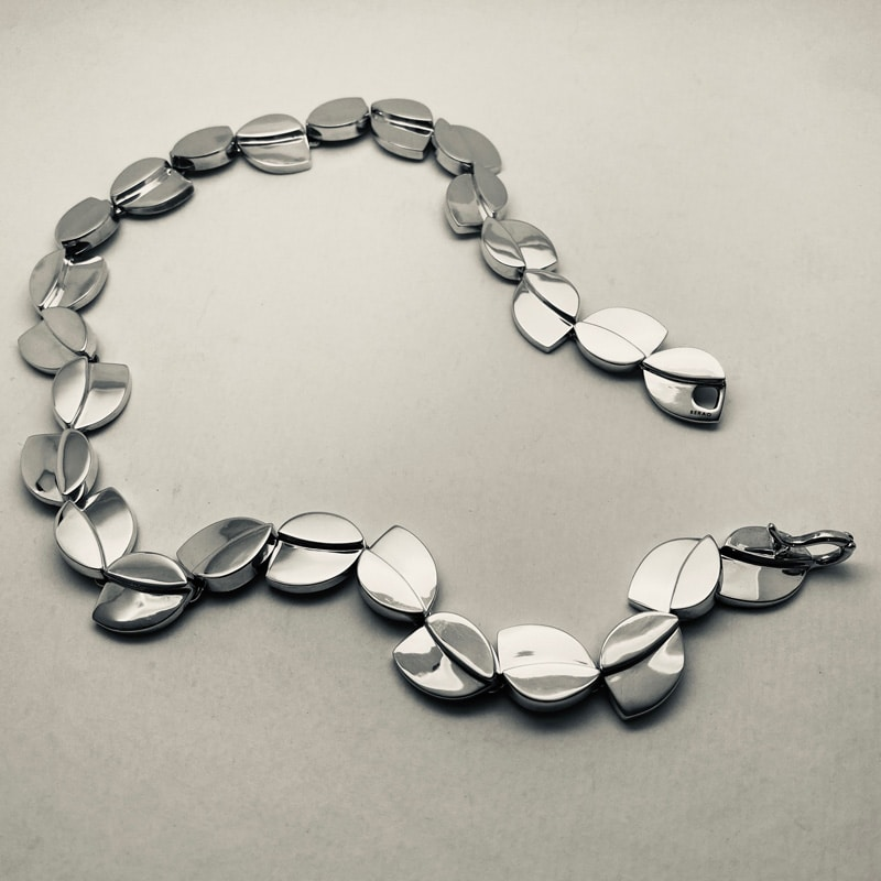 Silver necklace with overlapping leaves