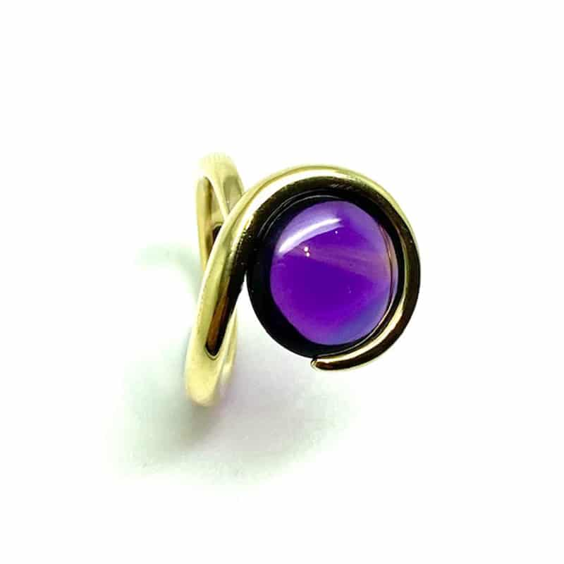 Gold ring hugging amethyst