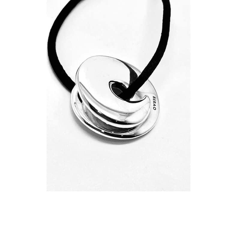 Colgante de plata doble caracola