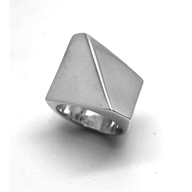 Silver ring with gabled planes