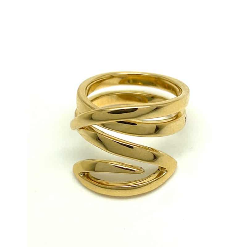 Coiled gold ring ending in ellipse