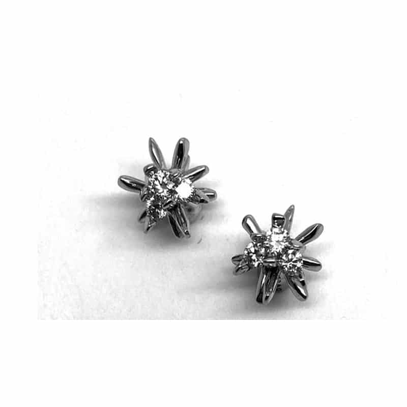 Gold and diamond star earring