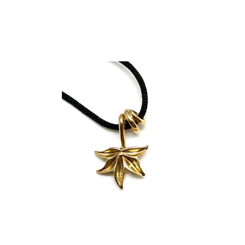 Simple gold pendant tangled branch ending in leaf